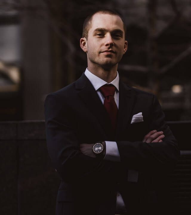 man-wearing-black-notched-lapel-suit-jacket-in-focus.jpg